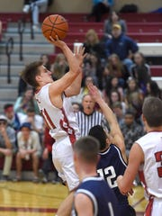 Matt Light drops a two point shot in from the top of the key. Annville-Cleona's The Dutchmen boys defeated Lebanon Catholic 51-45 at home Jan. 19.