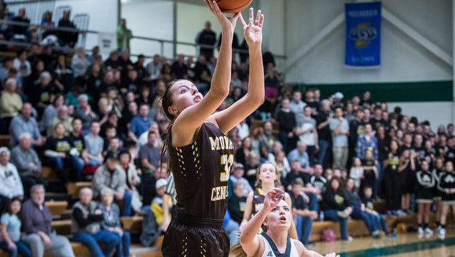 Monroe Central's Abigail McGrath shoots past Madison-Grant's defense during their game at Eastern High School in Greentown Saturday, Feb. 11, 2017.