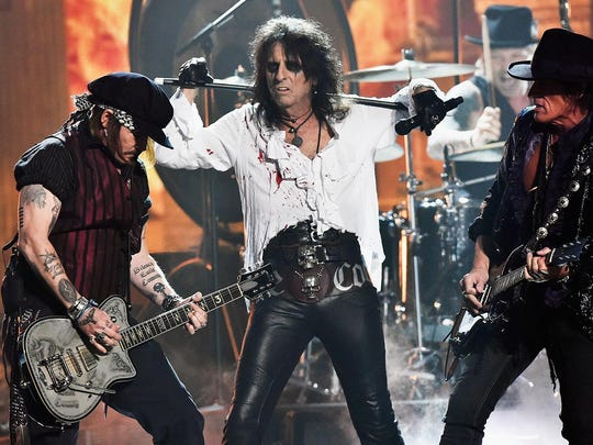 Johnny Depp, left, Alice Cooper and Joe Perry of the Hollywood Vampires at the 58th Grammy Awards in February.