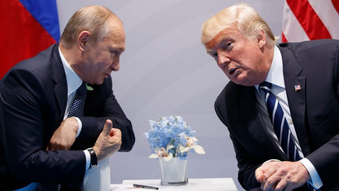 President Trump, right, meets with Russian President Vladimir Putin, left, at the G-20 summit in Hamburg on July 7, 2017. The two leaders would like to meet on the sidelines of an conference of Asian leaders in Da Nang, Vietnam, Friday, Nov. 10, 2017.