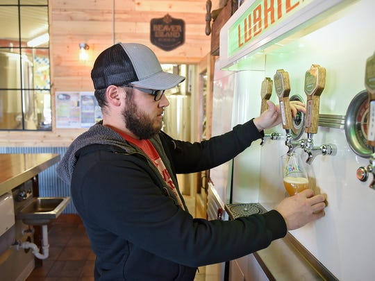 Beaver Island Brewing Co. co-founder Nick Barth pours a glass of Maibock Saturday at the St. Cloud brewery. The brewery will host a Mai Bock celebration Saturday , which will be attended by 74 delegates from Spalt, Germany.
