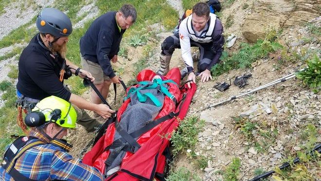 Paramedics work to get Yvonne Haas off Bridger Ridge.