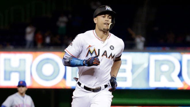 Stanton rounds the bases after hitting his 55th home run of the season on Monday.
