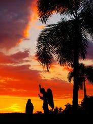 Sunset at the entrance to Ave Maria University on Sunday.