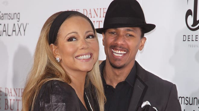 """Mariah Carey and Nick Cannon attend """"The Butler"""" premiere in New York last year."""