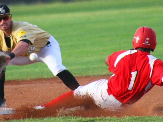 White Sands shortstop Aaron Sheaks tries to put out Alpine's Brandon Pugh.