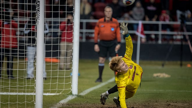 Louisville's Will Meyer (1) misses the last penalty kick during the NCAA Mens Quarterfinal Soccer Match played against Akron at Lynn Stadium in Louisville, Kentucky, Friday, December 1, 2017