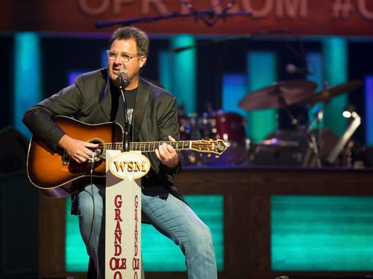 Vince Gill performs at the Grand Ole Opry in 2015.