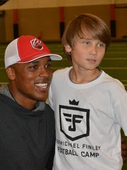 Jermichael Finley poses for a picture as his football