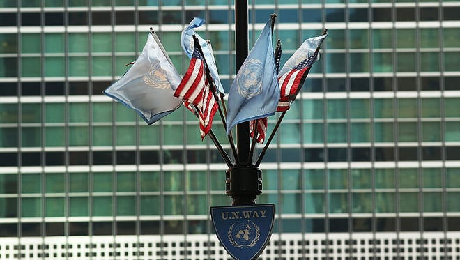 NEW YORK, NY - JANUARY 26:  The United Nations flag flies with American flags outside of the international organization on January 26, 2017 in New York City. President Donald Trump is preparing executive orders that would reduce US funding of the United Nations and other international organizations. The first order would cut funding for any U.N. agency or other international group that meets any specific criteria. Organizations and groups to receive cuts may include peacekeeping missions, the International Criminal Court and the United Nations Population Fund.  (Photo by Spencer Platt/Getty Images)