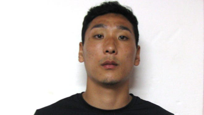 Byong Oh Kim is shown in his booking mugshot at the Guam Department of Corrections.