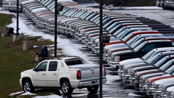 Chevy trucks line the lot of a dealer in Murrysville, Pa. Many local auto dealerships are overflowing with sedans, trucks and SUVs, so there are deals to be had. Most dealers have abundant supplies of 2013 models, and 2014s are arriving as automakers keep their factories humming. Since dealers pay interest on money borrowed to buy the cars, they'?re probably anxious to sell them by the end of the year.