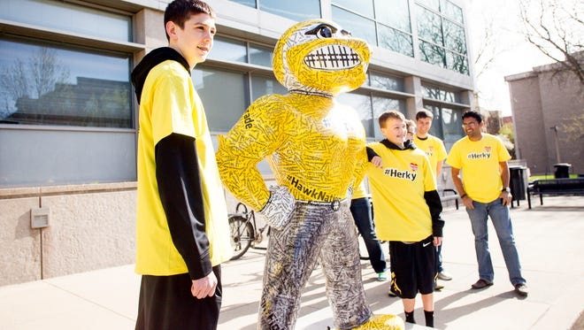 Patrick McCaffery, son of Iowa Men's Basketball Head Coach Fran McCaffery, and friend Austin Schroeder unveil the #Herky statue as part of the Herky On Parade series along Iowa Avenue in Iowa City, IA on Monday morning, May 5, 2014. Patrick McCaffery, 14, had a tumor surgically removed from his thyroid in March which was shown to be cancerous. He was asked to unveil the #Herky statue after his own #TeamPat was recognized across the country including NBA star Chris Paul with the L.A. Clippers.