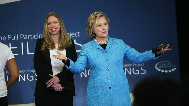 Hillary Rodham Clinton with her daughter, Chelsea Clinton, speaking at the Clinton Foundation's No Ceilings: The Full Participation Project at the Lower Eastside Girls Club on April 17, 2014, in New York City.