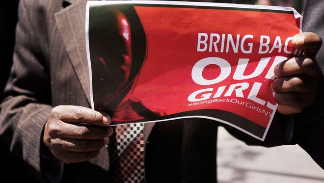 A person holds up a sign as local clergy, activists and and community leaders protest for the safe return of the 276 abducted schoolgirls outside the Permanent Mission of Nigeria to the United Nations on June 2, 2014 in New York City.