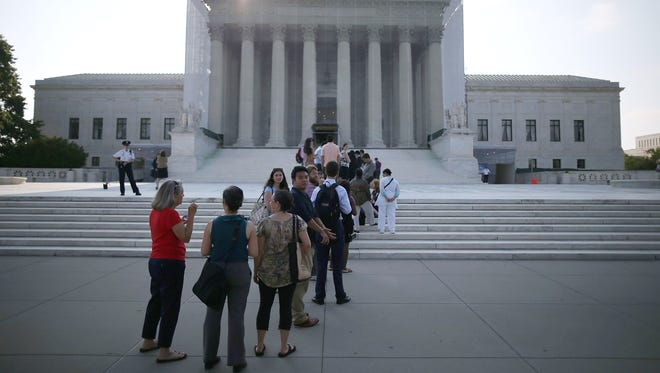 People wait to enter the Supreme Court in June.