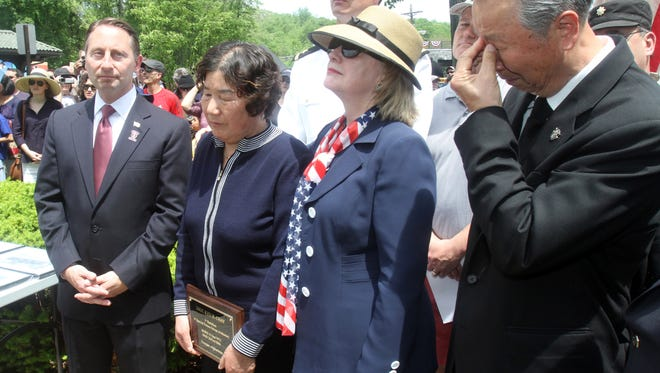 Westchester County Executive Rob Astorino and former U.S. Senator and Secretary of State Hillary Clinton stand with Sam and Soon Chay during a Memorial Day ceremony honoring their son Army Staff Sgt. Kyu H. Chay at Memorial Plaza in Chappaqua May 26, 2014. The ceremony followed the New Castle Memorial Day, which ended at the plaza.  At the ceremony, the route 120 bridge over the Saw Mill Parkway was named in honor Army Staff Chay, an area resident who was killed in 2006 fighting in Afghanistan.