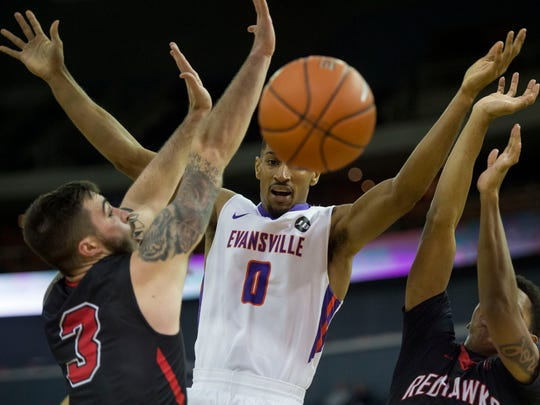 University of Evansville's Ryan Taylor (0) looks towards the ball after it was blocked by Southeast Missouri's Ray Kowalski (3) as the University of Evansville Purple Aces take on the Southeast Missouri Redhawks at the Ford Center in Evansville, Ind., on Thursday, Nov. 16, 2017. The Purple Aces won 66-50.