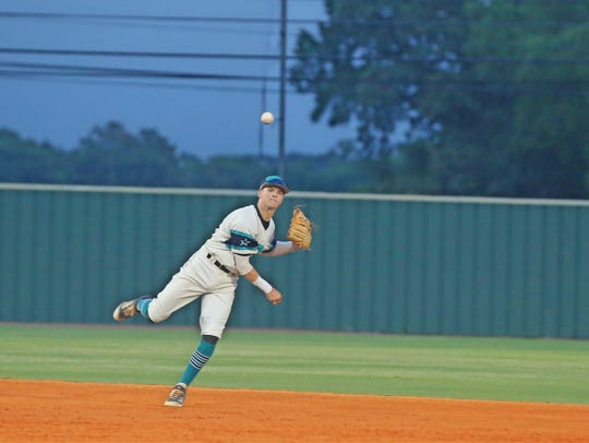 Siegel shortstop Drew Benefield fires to first for