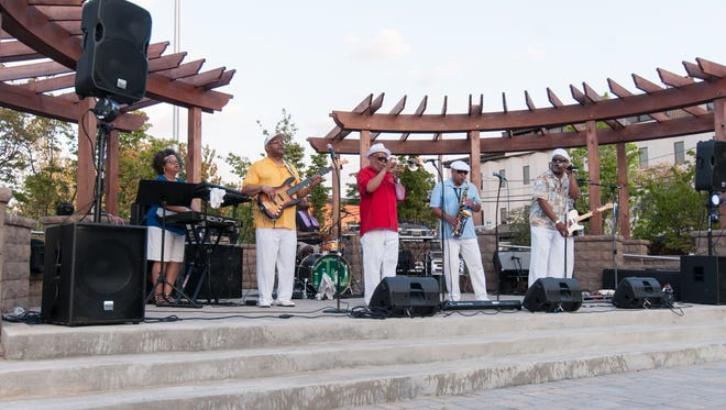 The Total Eclipse Band entertains local area residents at the Atlantic Street Park in July, 2016.