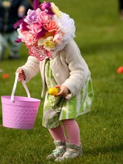 Agnes roper, 3, wears a festive Easter hat covered