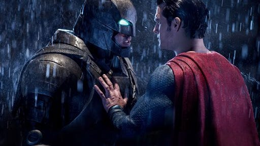 "This image released by Warner Bros. Entertainment shows Ben Affleck as Batman, left, and Henry Cavill as Superman in a scene from, ""Batman V. Superman: Dawn Of Justice."" (Clay Enos/Warner Bros. Entertainment via AP)"