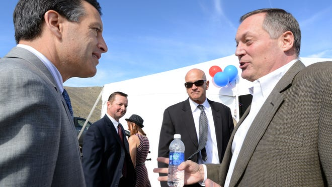 Nev. Gov. Brian Sandoval talks with Mark Hilborn, senior vice president of petco before the ground breaking ceremonies on the company's new distribution center on Red Rock Road Thursday Oct. 16, 2014.