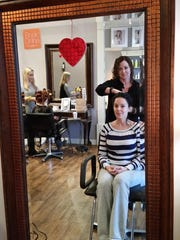 Reflected in one of the mirrors inside her Bernardsville salon, Terri Hebert talks about hair with Daniela Paixão e Silva. Hebert entered the business in 2002 after the salon in which she worked as a stylist was sold.