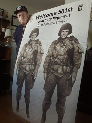 John Cipolla had a huge poster made of himself (left) and his best buddy Robert Harwell, who now lives in Norfolk, Va. Cipolla was a paratrooper with the 101st Airborne Division and was wounded during the Battle of the Bulge. (Dec. 2014)