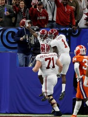 Jan 1, 2018; New Orleans, LA, USA; Alabama Crimson Tide wide receiver Calvin Ridley (3) celebrates with wide receiver Robert Foster (1) after scoring a touchdown against the Clemson Tigersduring the first quarter of the 2018 Sugar Bowl college football playoff semifinal game at Mercedes-Benz Superdome. Mandatory Credit: Greg M. Cooper-USA TODAY Sports