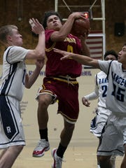 Tulare Union's Kazmeir Allen drives for two against
