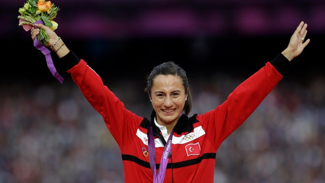 Turkey's Asli Cakir Alptekin agreed to give up her 1,500-meter title for blood doping.