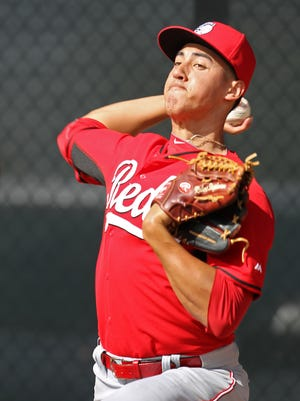Reds prospect and non-roster invitee Robert Stephenson throw during drills.