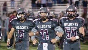 Cam Maier (center) walks with his Mount Vernon teammates.