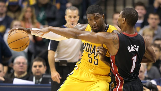 Pacers Roy Hibbert backs down Chris Bosh. Indiana Pacers defeated the Miami Heat 90-84Tuesday, December 10, 2013, evening at Bankers Life Fieldhouse.
