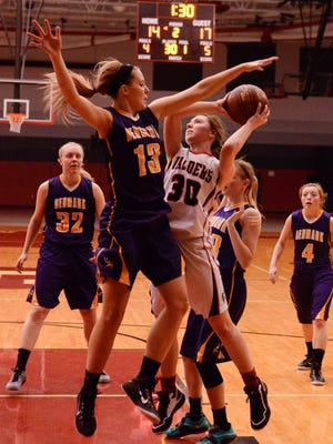 Valders' Alissa Wagner goes up for a shot under heavy pressure by Denmark's Britney Petersen during the WIAA Div. 3 sectional semifinal game at Sheboygan South High School.