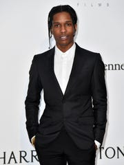US rapper ASAP Rocky poses as she arrives for the amfAR's