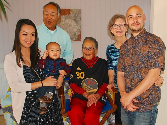 Four generations of the Lowe family pose for a photo. They are Angel Lowe, her son Malcolm Lowe II, Marian D. Lowe, Malcolm's great-grandmother; Geoffrey Lowe, Malcolm's father; and Bonnie and Greg Lowe, Malcolmn's grandparents