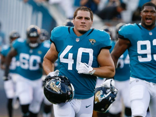 Jacksonville Jaguars fullback Tommy Bohanon (40) runs out of the locker room and onto the field during 2018 preseason game. Bohanon played the past two seasons with the Jaguars but is a free agent as the NFL's 100th season begins.