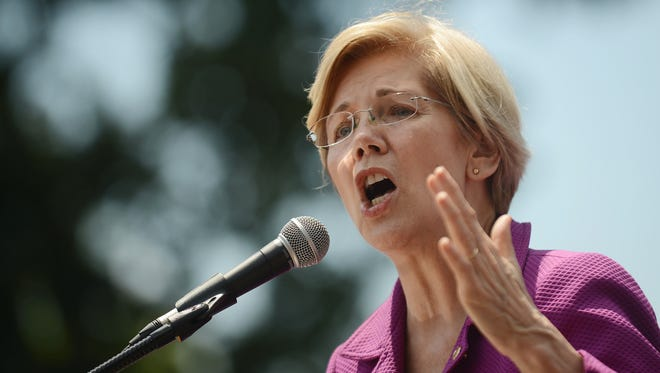 Sen. Elizabeth Warren, D-Mass., speaks at a rally on Capitol Hill on June 21, 2017.