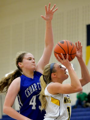 Eastern York's Hannah Myers puts up a shot while being