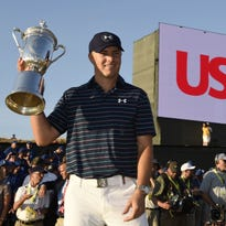 Jun 21, 2015; University Place, WA, USA; Jordan Spieth poses for a photo with the U.S. Open Championship Trophy after winning the 2015 U.S. Open golf tournament at Chambers Bay. Mandatory Credit: John David Mercer-USA TODAY Sports