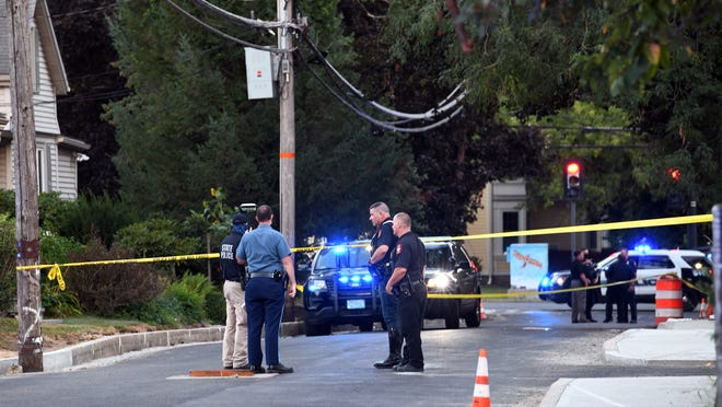 Police investigate at the scene of Tuesday night's hit-and-run accident, which left two pedestrians with life-threatening injuries after they were struck by a truck on Washington Avenue, near the intersection of Summer Street, Aug. 18, 2020.