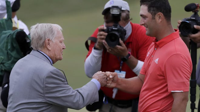 Jon Rahm, of Spain, right, is congratulated by Jack Nicklaus after winning the Memorial golf tournament, Sunday, July 19, 2020, in Dublin, Ohio.