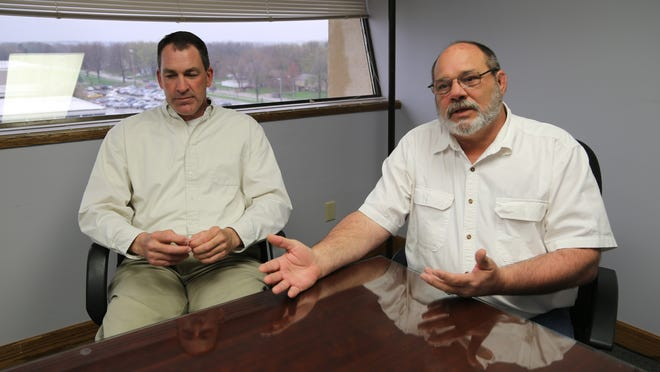 State transportation employees Steven Scott, left, and Ken Morrow were illegally fired in 2012.