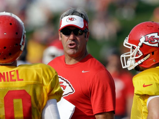 FILE - In this Aug. 4, 2015, file photo, Kansas City Chiefs offensive coordinator Doug Pederson, center, attends NFL football training camp in St. Joseph, Mo. Pederson has accepted an offer to become the Philadelphia Eagles coach, a person with knowledge of the decision told The Associated Press on Thursday night, Jan. 14, 2016. The person spoke on condition of anonymity Thursday because the Eagles have not officially announced the hiring. (AP Photo/Orlin Wagner, File)