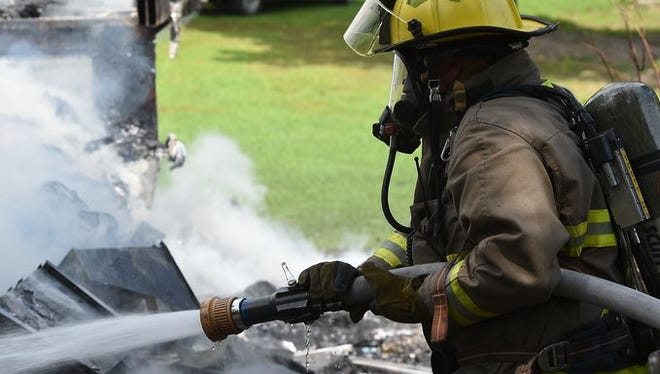 A Mountain Home firefighter extinguishes a camper fire in July. The department responded to more calls in 2015 than 2014.