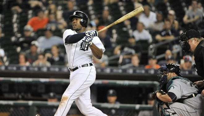 Justin Upton hits a walk-off homer in the 12th inning against the Mariners Monday.