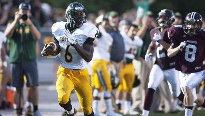 Sean Jones (6) rushes for a touchdown in last year's 49-7 win at Owen.