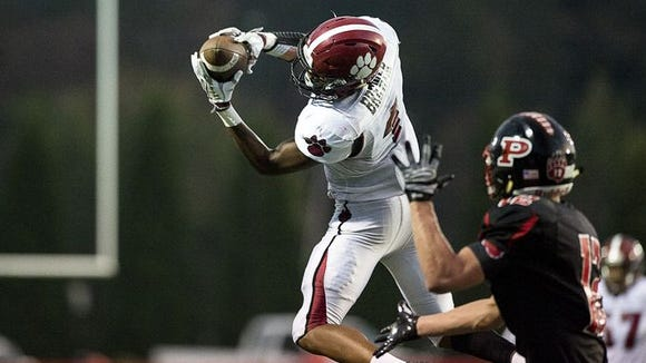 Asheville High's Makaius Brewer goes up to make a catch in Thursday's 17-14 loss at Pisgah.